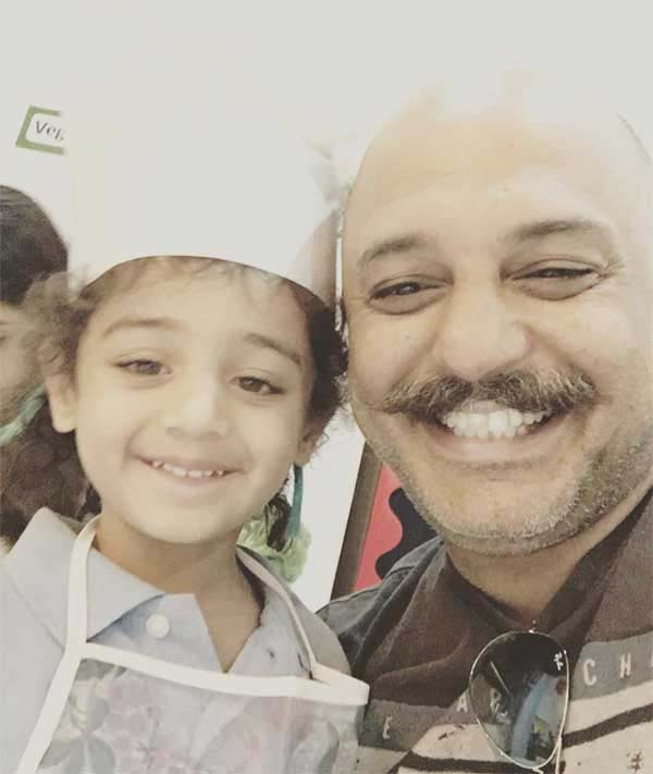 Ali Azmat with his daughter