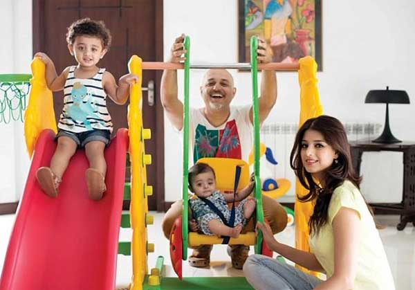 Ali Azmat with daughters and wife
