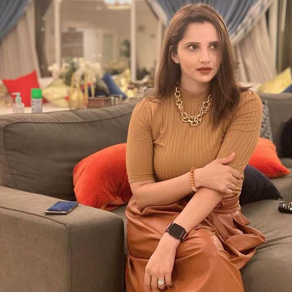 Sania Mirza wearing elegant brown dress